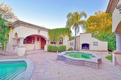 $3.5M IS THE PRICE FOR THIS PARADISE VALLEY BANK OWNED OLD WORLD ESTATE