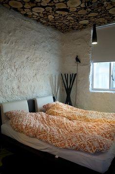 Interesting Bedroom - Log Ceiling - Stucco Walls