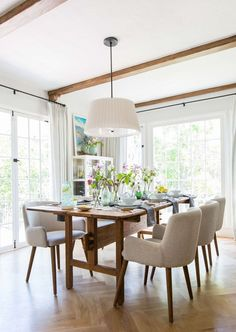 Modern Dining Room In Neutral Tones Featuring A Rustic Wood Table, Beige  Upholstered Chairs,