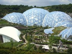 The Biomes at the Eden Project Cornwall. off with this link. Eden Project, Unique Buildings, Interesting Buildings, Cornwall Garden, Cornwall Cottages, Cornwall England, Futuristic Architecture, Retro Futuristic, Biomes