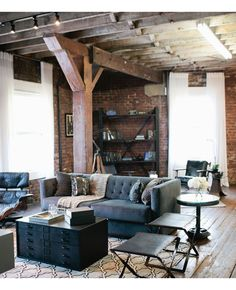 love the raw wooden beams and floor, against the brick walls