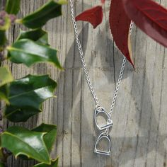 Remarkably simple, yet fantastically fetching, sterling stirrups intermingle to create a uniquely stunning necklace.