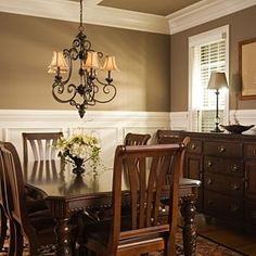 Traditional dining room with sage green paint color for Formal dining room color ideas