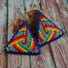 Beaded triangle earrings in rainbow colors. Earrings are made very carefully and accurately of Japanese beads Delica.  Total length:5.2 cm ( 2 inches ) The sides of the triangle are 3.7 cm ( 1 1/2 inches )  I suggest you look at the similar product chocolate