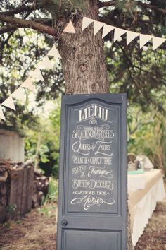 Add a little vintage flair to your reception by painting the dinner menu on an old door.