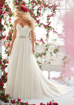 Asymmetrically Draped Bodice with Shoestring Straps on Soft Net Wedding Dress Designed by Madeline Gardner. Removable Beaded Satin Belt.