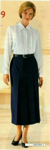 Bet she's strict. -  High buttoned blouse with tie neck, Straight pleated skirt.