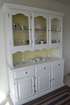 white china hutch with a pop of color in the back is more versatile. You could easily change the color in the back if/when your decor and color palette changes without having to redo the entire piece. Hmmmm?