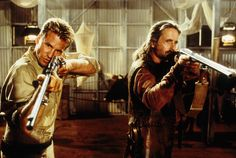 "Val Kilmer and Michael Douglas ~ ""The Ghost and the Darkness"" (1996), based on a true story of the hunt for two man-eating lions during a bridge building project in East Africa in 1898"