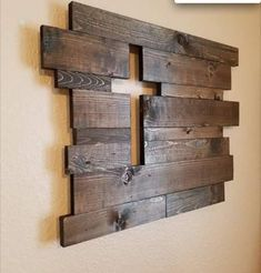 This is a very nice use of reclaimed wood stained to create a rich look when hung on a light-colored wall that accentuates the Cross. This is my favorite of similar items I've viewed. The photo is so buried in the link that I gave up trying to find the source. Too bad, because the creator isn't getting acknowledgement for his/her work. Barn Wood Walls, Reclaimed Wood Walls, Barn Wood Furniture, Pallet Wood, Wood Interior Walls, Pallet Fireplace, Rustic Wood Wall Decor, Cross Wall Decor, Dining Room Wall Decor
