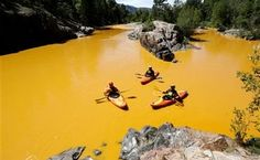 A plume of orange muck from a large mine waste spill in Colorado has drifted about 55 miles (90 kilometers) downriver and is closing in on New Mexico, prompting communities to take precautions until the sludge passes.