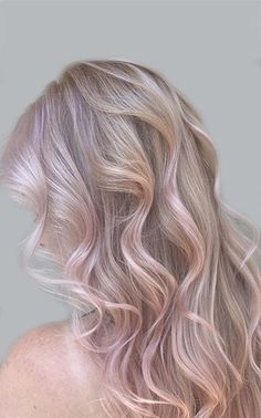 light pink pastel hair color's gentle essence embodies the qualities of the rose quartz stone