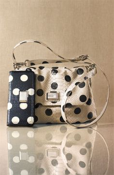 "I am loving the MARC BY MARC JACOBS ""Dotty Snake Little Ukita"" line. I have the key chain, but I definitely want the matching wallet/ handbag"