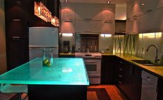 Pretty cool -- glass counter top for kitchen island.  Island Light