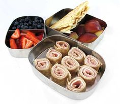 "Easy lunch box ideas: ham and cream cheese ""sushi"" on a whole-wheat tortilla, peanut butter and jelly on naan, strawberries, blueberries and plums"