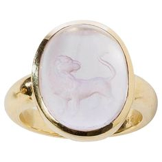 Rose Quartz Lion Intaglio Gold Ring   From a unique collection of vintage cocktail rings at https://www.1stdibs.com/jewelry/rings/cocktail-rings/