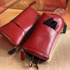 Back by customer demand, with a few key improvements, this leather eyeglass case allows you to carry two pairs of glasses in one compact case.