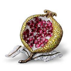 Michelle Ong    Simply stunning pomegranate clip with white, fancy yellow and brown diamond in platinum and yellow gold.