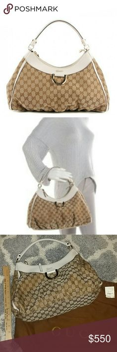 Gucci monogram D-ring hobo bag This is an authentic GUCCI Monogram Medium D Gold Hobo in Off White. This GUCCI bag features brown gucci monogram canvas with white leather trim and light gold hardware including a decorative D-ring on the front. The top zipper opens to a brown fabric with a zipper and cell phone pocket.   Original tags and care card included. In excellent condition. Used only a few times. Check my listing for matching wallet. Gucci Bags Shoulder Bags
