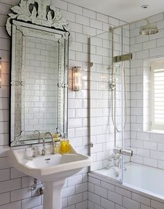 This Venetian mirror is the star of the show in this bathroom, shifting attention from the shower-bath. Decorative wall lights and traditional silver hardware fit with the mirror without overpowering the room. Find out which bathroom basin is ideal for you. ➤ Discover the season's newest designs and inspirations. Visit us at http://www.wallmirrors.eu #wallmirrors #wallmirrorideas #uniquemirrors @WallMirrorsBlog