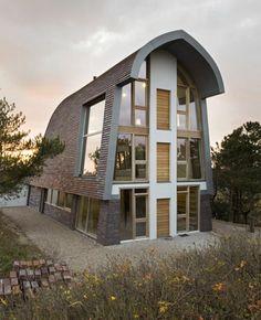 Haus in den Dünen von Min2 bouw-kunst | DerTypvonNebenan.de