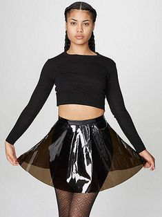 A classic circle skirt in a flexible and see through material featuring side zipper and button closure.
