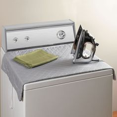 portable quilted ironing pad--heat resistant, sturdy magnets in each corner to hold it flat on your designated heat-safe surface.  Folds/rolls up when finishes or can even be stuck onto the side of your washer/dryer since it has great magnets!