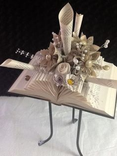 Folded book on stand by ART in HEART: