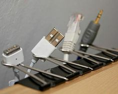 House and Home -- Organise cables -- Stop wasting time detangling your electrical cables and organise them once and for all. We love this simple yet effective use of bulldog clips to hold cables on the edge of a desk. Better yet, go for wireless options where you can to reduce the cluttered look of endless wires.