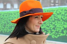 The perfect orange hat (http://www.mydailylondon.com/2012/03/the-perfect-hat)