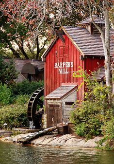"""Harpers Mill in Frontierland at Magic Kingdom Park, Orlando, FL.  """"Did you know the gears inside Harper's Mill creak to the tune of Down by the Old Mill Stream? There's Tom Sawyer's raft resting on the shore in front of the mill."""""""