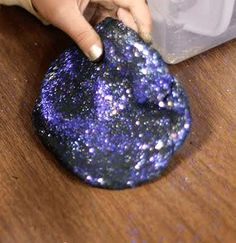Glitter Playdough! Be the coolest mom on earth (well you don't even have to be a mom) and make this galaxy playdough for a fun play date.