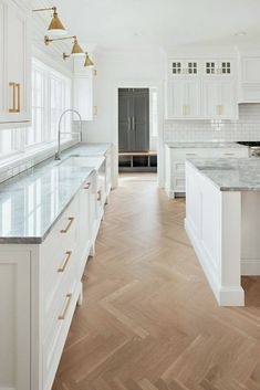 Herringbone wood floor in white kitchen by The Fox Group. Come be inspired by 11 White Kitchen Design Ideas Adding Warmth! Home Decor Kitchen, Interior Design Kitchen, Kitchen Ideas, Kitchen Hacks, White Kitchen Interior, Kitchen Decorations, Contemporary Interior, Kitchen Furniture, Interior Ideas