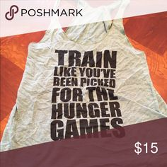"""Work out shirt Work out shirt with cute saying. """"Train like you were picked for the hunger games"""". I ❤️ this shirt but it is too small for me 🙁 Tops Tank Tops"""