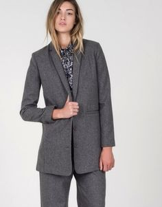 Constructed in a premium structured wool blend, this slim, extra long blazer is a one-of-a-kind modern update for your tailored style. By Lucca exclusively for Wildfang.