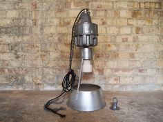 Industrial aluminium light has been rewired to suit domestic 240v use New black braided cabel and standard domestic bayonet holder fitted Original ceramic bulb holder casing stripped and polished with a metal lacquer to finish Included is a polished aluminium ceiling hook.