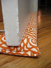 Sewing tutorial for the best homemade door draft stopper I think I've seen.