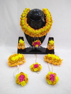 A beautiful yellow colored floral jewellery set with magenta as a highlighter used for haldi functions in indian Flower Jewellery For Haldi, Indian Jewelry Earrings, Jewelry Design Earrings, Flower Jewelry, Diamond Jewelry, Jewelry Sets, Jewelry Necklaces, Thread Art, Silk Thread