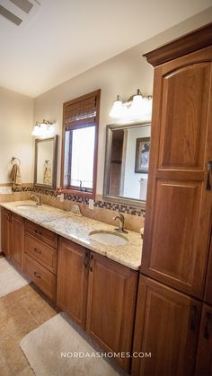 This traditional bathroom with double vanity cabinets offer a beautiful, rich finish. In addition to the traditional design, this cabinetry features a classic raised panel door style. This house floor plan designed and built by Nordaas Homes, a full-service custom home builder in Minnesota. We have a variety of house plans--from single story, two story, small homes and more...all tried, tested & actually built, so you know you'll love them. Home Design Floor Plans, Plan Design, House Floor Plans, Bathroom Styling, Bathroom Interior Design, Interior Ideas, Modern Farmhouse Bathroom, Classic Bathroom, Traditional Bathroom