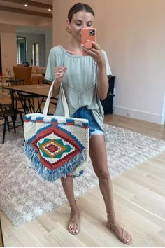 I love this bag for summer. I paired it with a mint green mint top and denim shorts.
