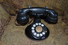 1920's Western Electric 102. These early phones were the first W.E. sets that used handsets as opposed to separate receiver and transmitter. Has the curvy Art Deco E-1 handset and a round base; some think the round base was utilized to use up the remaining stocks of round bases formerly destined for use as candlestick phones. I'm not convinced as there are differences between this base and the candlestick base. In any case, the 102 is a fairly rare phone. This one is as-found, unretouched.