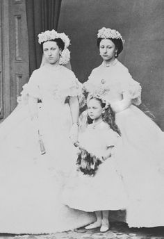 teatimeatwinterpalace: Princess Helena, Princess Louise and Princess Beatrice in the dresses worn at the wedding of their eldest brother Albert Edward Prince of Wales, 10 March Princess Louise wears miniature of her father Prince Albert at her breast. Queen Victoria Children, Queen Victoria Family, Queen Victoria Prince Albert, Victoria And Albert, Princess Louise, Princess Beatrice, Prince And Princess, Royal Brides, Royal Weddings