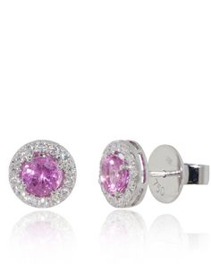 Classic and elegant studs in 5mm pink sapphires (1.45 cts) are enclosed with diamonds (0.43 cts). 18K White Gold Earrings