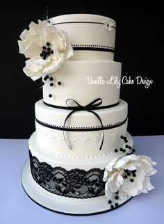 Black and white cake with lace and flowers