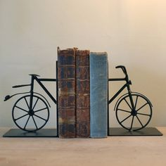 Handsome set of metal bicycle bookends These elegant black metal vintage style bicycle bookends are a great gift idea for keen cyclists . Perfect for a smart desk or for adding a touch of character to a living room . They are pleasingly weighty and will keep a row of hardback books or collections of magazines in order. A Great gift for Father's Day !MetalEach Bookend is 18cm H , Each Bookend base is approx 13.5 x 12 cm, Weight Approx 1Kg ( both )