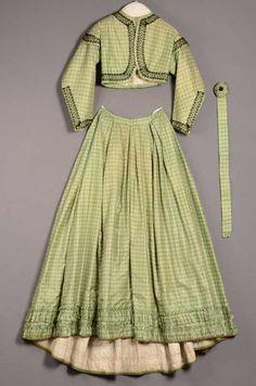 1862-64 green check silk ensemble (skirt, jacket, and belt). Centraalmuseum, Netherlands.