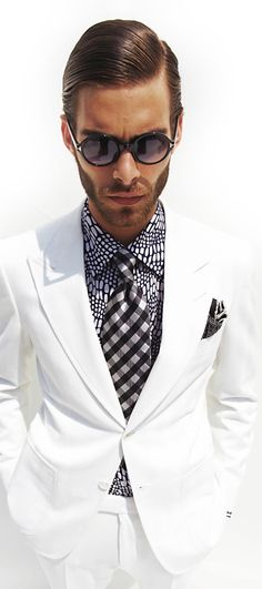 Tom Ford white suit...VERY DARING, but so stylish. The Dapper Tailor can make a white suit for £279