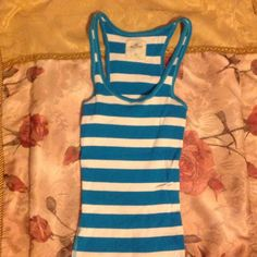 Turquoise Hollister Tanktop Used like new, no signs of wear or tear, striped design, classic fit, states size xsmall, but it is stretch material so it can also fit a small or small-medium ....(The more you buy, the more I lower my prices so bundle & save!!) Hollister Tops