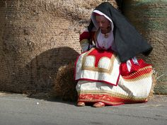 girl wearing traditional costume at sartiglia carnival, oristano, sardinia, italy