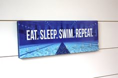 Swim Medal Holder.  Gorgeous full color photo.  Great gift for swimmers!  From York Sign Shop on Etsy.